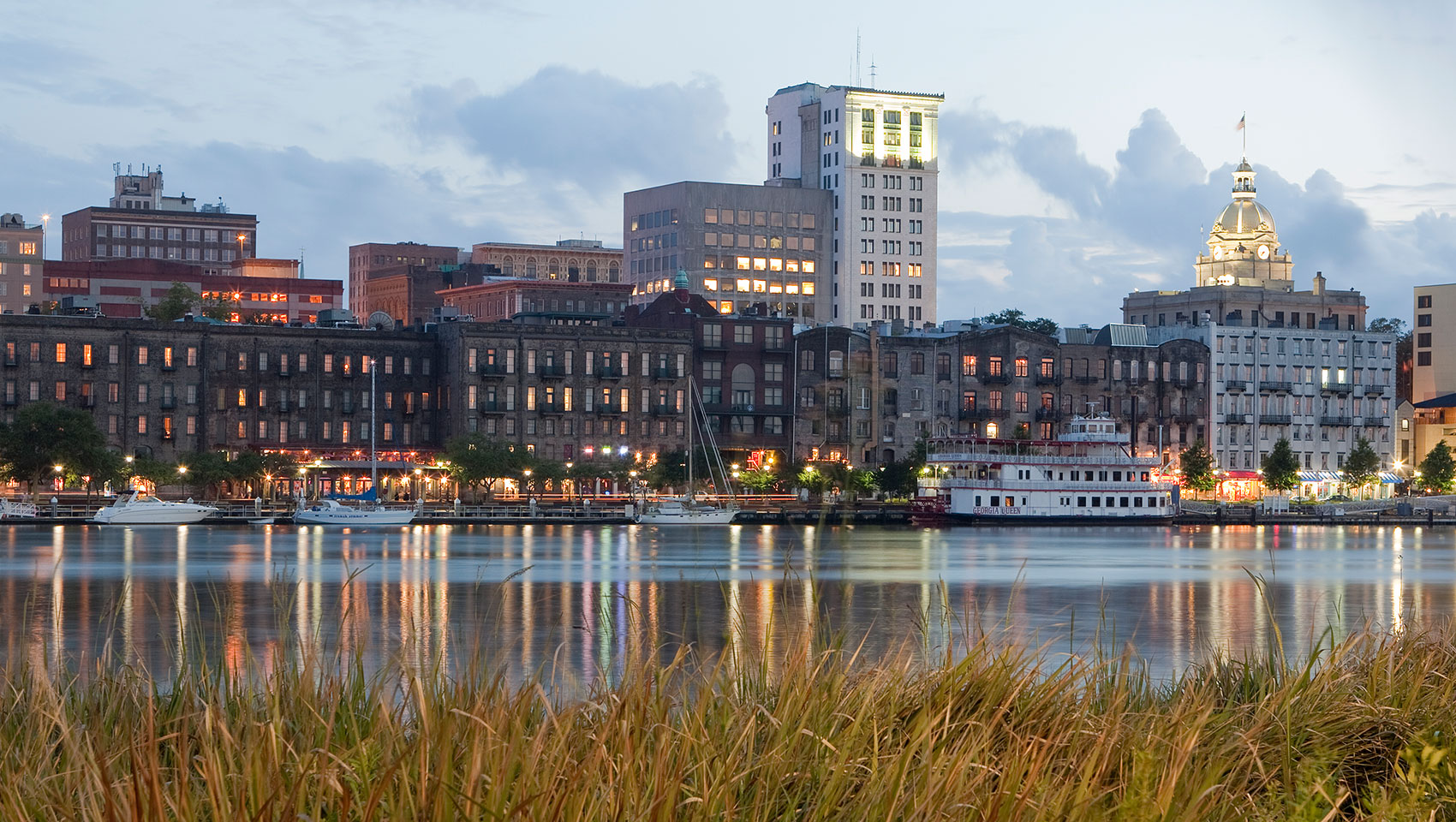 The Brice Hotel Savannah, GA. Image describes the Savannah skyline overlooking Riverwalk.